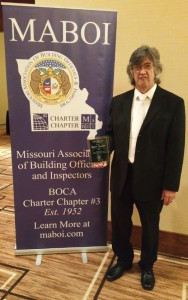 Roger Stewart of St. Peters receives the Louis E Stoppleman award